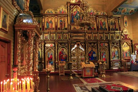 Beautiful iconostasis with ancient icons set in golden frames. Religious work of art in church. Inside Slavonic church