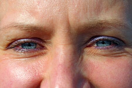Female blue eyes. Face of attractive woman close up