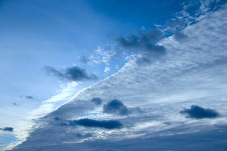 Beautiful white clouds on blue sky background. White clouds on boundless sky. Blue sky with white clouds. Landscape and blue sky. Heaven view. Celestial panorama