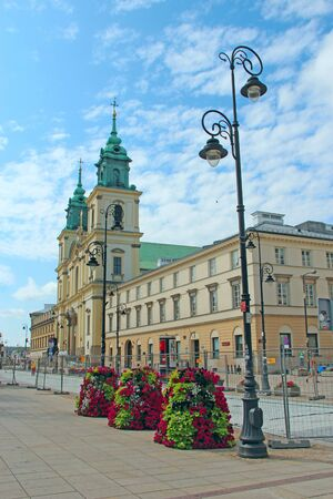 Islands of nature in modern city. Coexistence of nature and modern city. Beautiful flower beds in city. Urban nature in Warsaw. Floral decoration in city street 에디토리얼