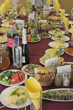 Festive table with delicious dishes. Many food on table for family holiday. Banquet table with delicious dishes in luxury restaurant. beautiful banquet table with snacks