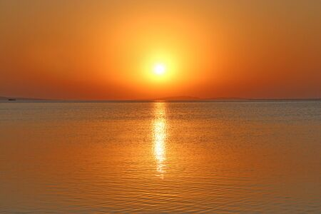 Dawn above sea. Beautiful summer decline above ocean. Beautiful blazing dawn landscape above Red sea and orange sky in early morning. Amazing summer sunset 스톡 콘텐츠