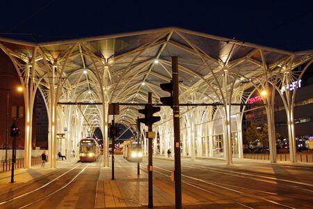 night tram riding around city. Lodz red tram. Modern tram going in evening city