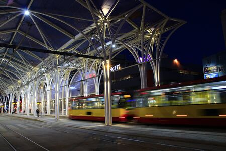 night tram riding around night city. Lodz red tram. Modern tram going in evening city