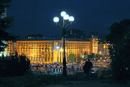 Panorama of Independence Square in Kyiv at night. Lights of night city. Panorama of central part of Kyiv illuminated by lights at nighttime. Kyiv at night. Urban night light 스톡 콘텐츠