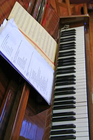Piano with notes are ready to play. Keyboard musical instrument. Notes for playing on piano. Music concept Imagens