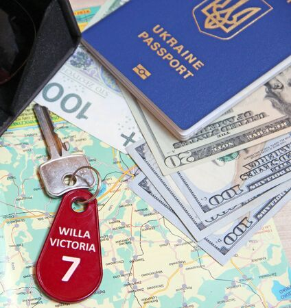 money passport and villa keys. Travel concept. Things for travel. Everything you need for vacation. Money map key to villa. Dollars and zloty prepared for summer vacation. Passport money and room key