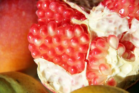 broken ripe pomegranate close up. Ripe seeds of pomegranate close up. delicious fruits. Useful food. Health care. tropical fruits