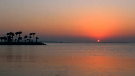 Sunset above sea. Beautiful summer decline above ocean. Beautiful blazing sunset landscape above Red sea and orange sky in early morning. Amazing summer sunset