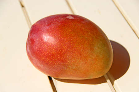 Ripe mango fruit close up. Delicious fruit. Useful food. Health care. Tropical fruit of mango