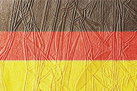 Germany flag on rumpled surface. Germany flag on scratched surface. German flag on textured background. National flag of Germany. German flag on old paper texture background