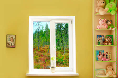 window in the nursery with a taiga view. Cozy children room and sunset in the window