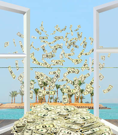 Heap of dollars flying away from window overlooking tropical island. Dollar bills by opened window with landscape. Money on the background of sea and palm trees. Spending money