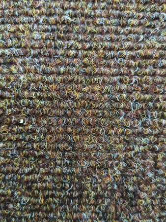 Wool texture. Background from gray wool. Fleecy background. Background of fleecy carpet. Texture of gray-brown carpet. Fleecy surface. Close up of texture of gray pattern of fleecy fabric Zdjęcie Seryjne
