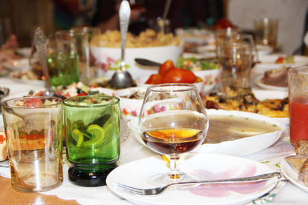 Holiday table setting. Festive table with delicious dishes. Many food on table for family holiday. Festive food served on table. Set of different meaty and vegetable dishes. Festive dinner at home Archivio Fotografico