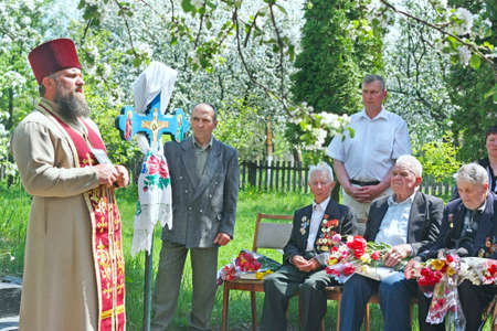 The priest blesses the war veterans. A blessing to war veterans from a church clergyman on the anniversary of the Great Victory over the Nazi invaders. Soviet Veterans of Second World War