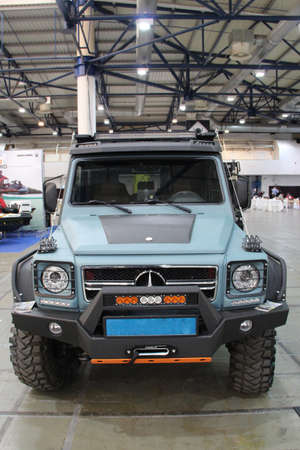 Off road car Mersedes Benz in sale at exhibition. Modern German car presented at exhibition in Kiyv. Famous German brand auto Mercedes Benz. Modern SUV car close up