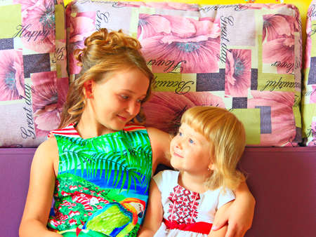 Little girls look at each other. Portrait of two sisters. Sisterhood. Happy children. older and younger sister eyes met. two beautiful girls looking at each other. children friendship. kids playing