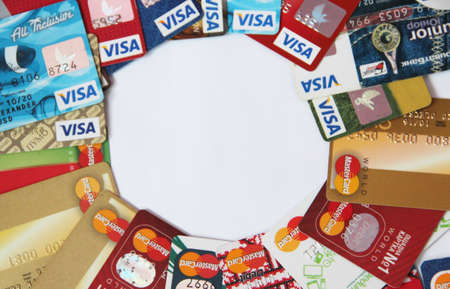 credit cards with VISA and Mastercard brand logo. Close up of many VISA and Mastercard credit cards. Plastic bank cards of VISA and Mastercard. International payment systems