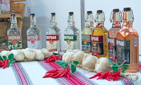 Pervak vodka presented at exhibition. Variety of assortment of vodka at exhibition. Ukrainian vodka Pervak. Alcoholic drinks. Spirits in assortment
