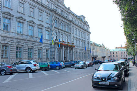 City panorama with beautiful architecture. Street in Lviv. City life. Traffic on street of Ukrainian city Lviv. City panorama with beautiful architecture and parked cars. Cars parked on street