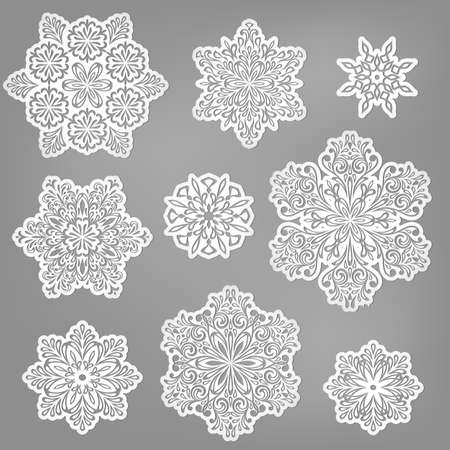 christmas wrapping: paper cut snowflakes
