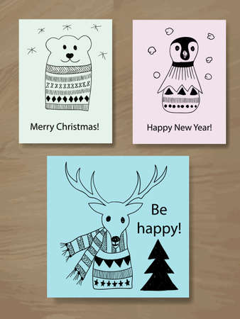 Vector Christmas Greeting Cards with Doodle Animals: reindeer, pinguin, and polar bear