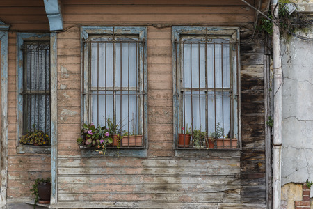paneling: Old wooden house wall paneling and window