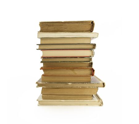 yellowed: Old, yellowed books on a white background