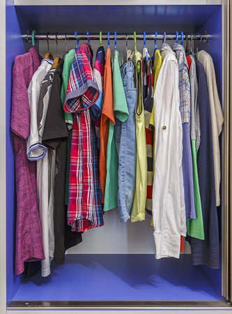 hangers: Wardrobe with hanging clothes on hangers