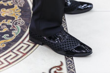 shiny suit: Wedding shoes groom standing on the marble floor