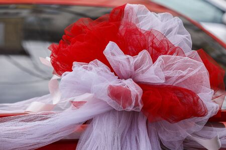 attached: Wedding decoration attached to the car