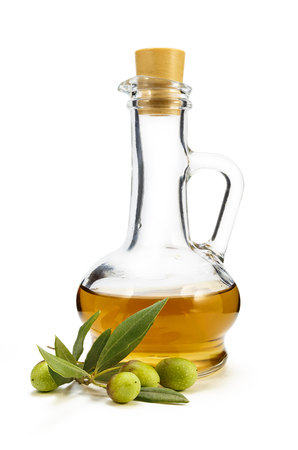 decanter: A branch of olive and olive oil in a decanter on a white background Stock Photo