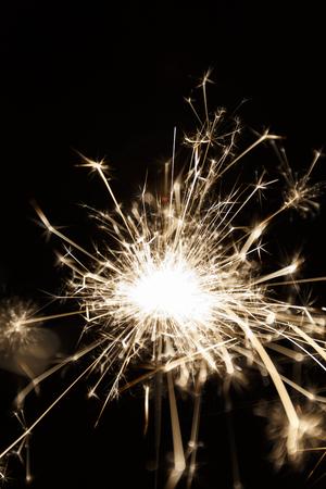 lighted: Lighted sparkler on a balck background (soft focus)