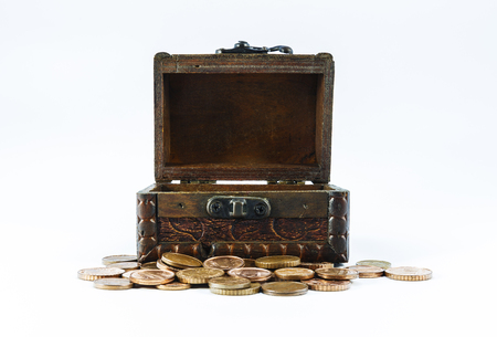 coppers: Old casket and small loose change on a white background