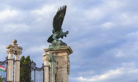 legendary: The mythical bird Turul holding claws paws powerful the legendary sword of Attila.Budapest.Buda castle