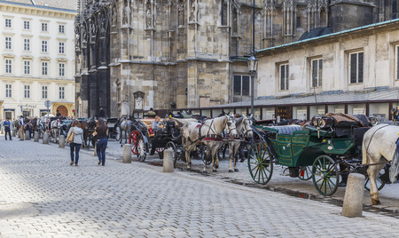 helen: AUSTRIA,VIENNA - APRIL 17,2016:Walking carriage in front of the cathedral of St. Stephen in Vienna