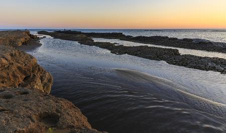 caspian: Rocks on the coast of the Caspian Sea near Baku at sunrise.Azerbaijan