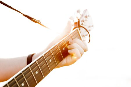 guy playing guitar: The young guy playing guitar in high-key(soft focus)