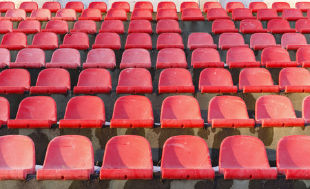 The old plastic seats in an abandoned stadium Stock Photo