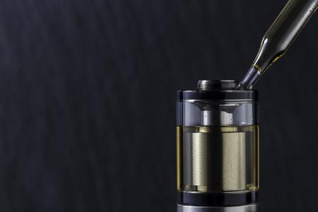 Filling a special liquid electronic cigarette Stockfoto