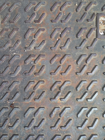 metal grate: The texture of the iron sewer hatch Stock Photo