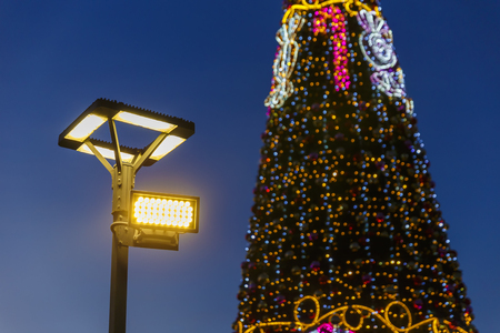 Street lamp and Christmas tree Stock Photo