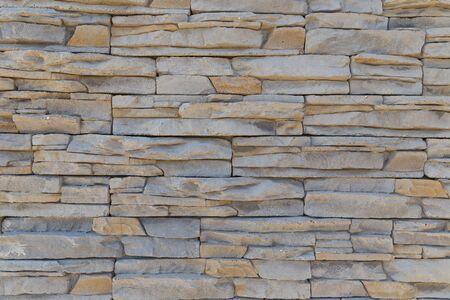 De textuur van de muur van een verscheidenheid aan gekleurde stenen Stockfoto