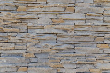The texture of the wall of a variety of colored stones Reklamní fotografie