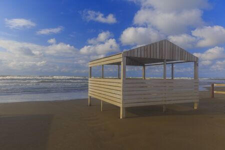 Beach gazebo overlooking the stormy sea