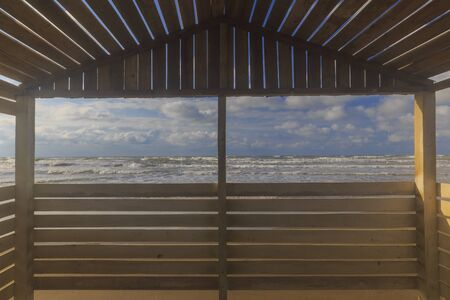 View from the beach gazebo to the stormy sea