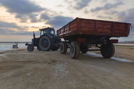 Tractor with a trailer delivering mined salt from a salt lake Banco de Imagens