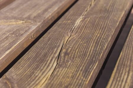 The texture of a wooden board on a bench
