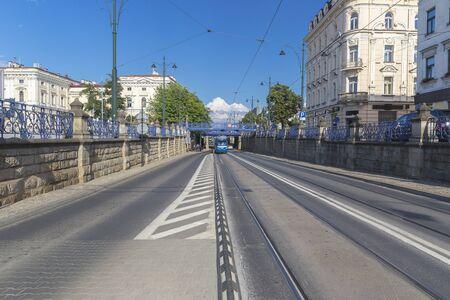 Tram passing under the bridge